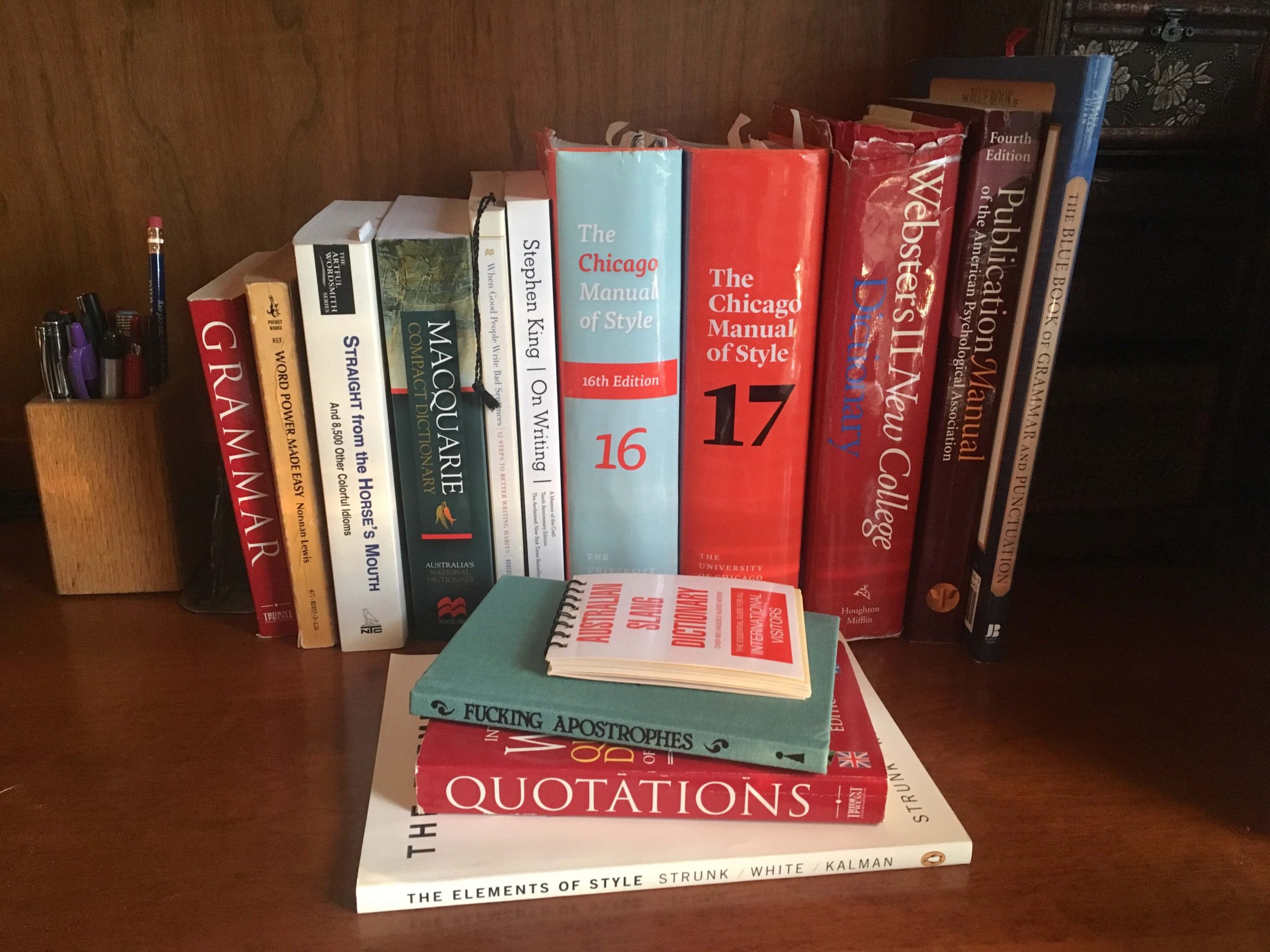 A shelf filled with books about copyediting and proofreading, the expertise you'll get when hiring a proofreader