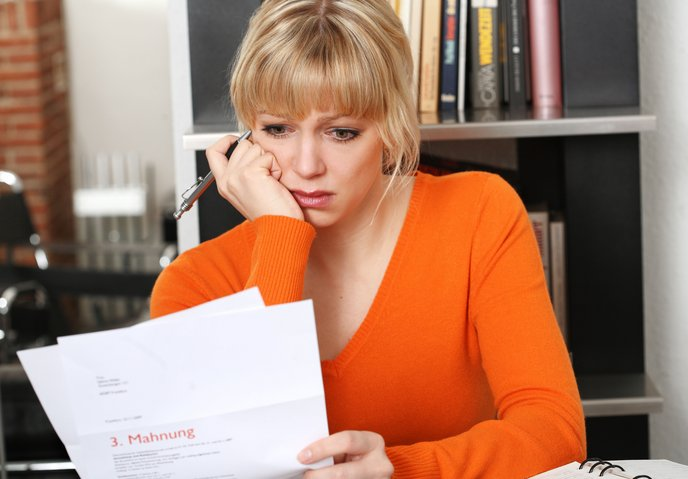 A woman upset at a non-empathetic letter she has received